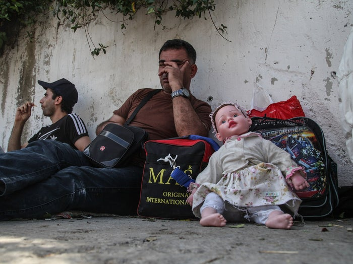 Refugees wait at a bus terminal in Istanbul.
