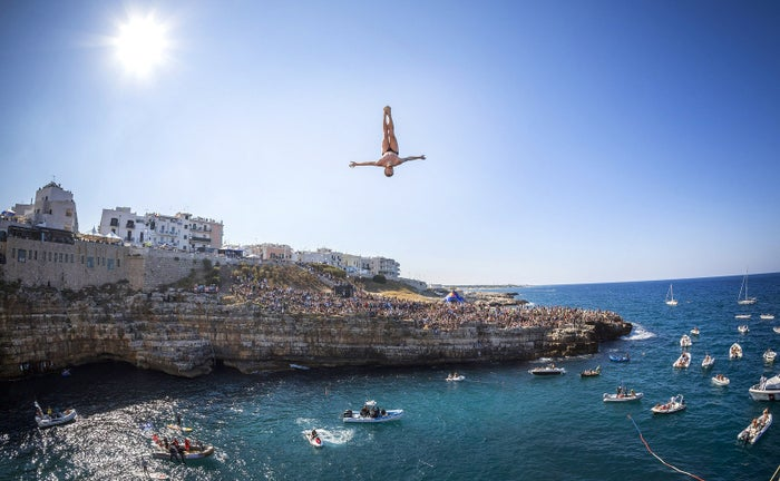 Andy Jones of the USA dives from the 27.5 meter platform during the seeding round of the seventh stop of the Red Bull Cliff Diving World Series, Polignano a Mare, Italy.