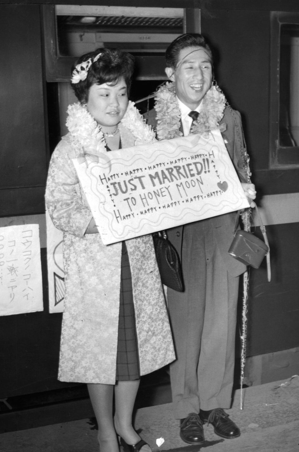 """A couple holds a sign """"Just Married"""" in Japan. 1955."""