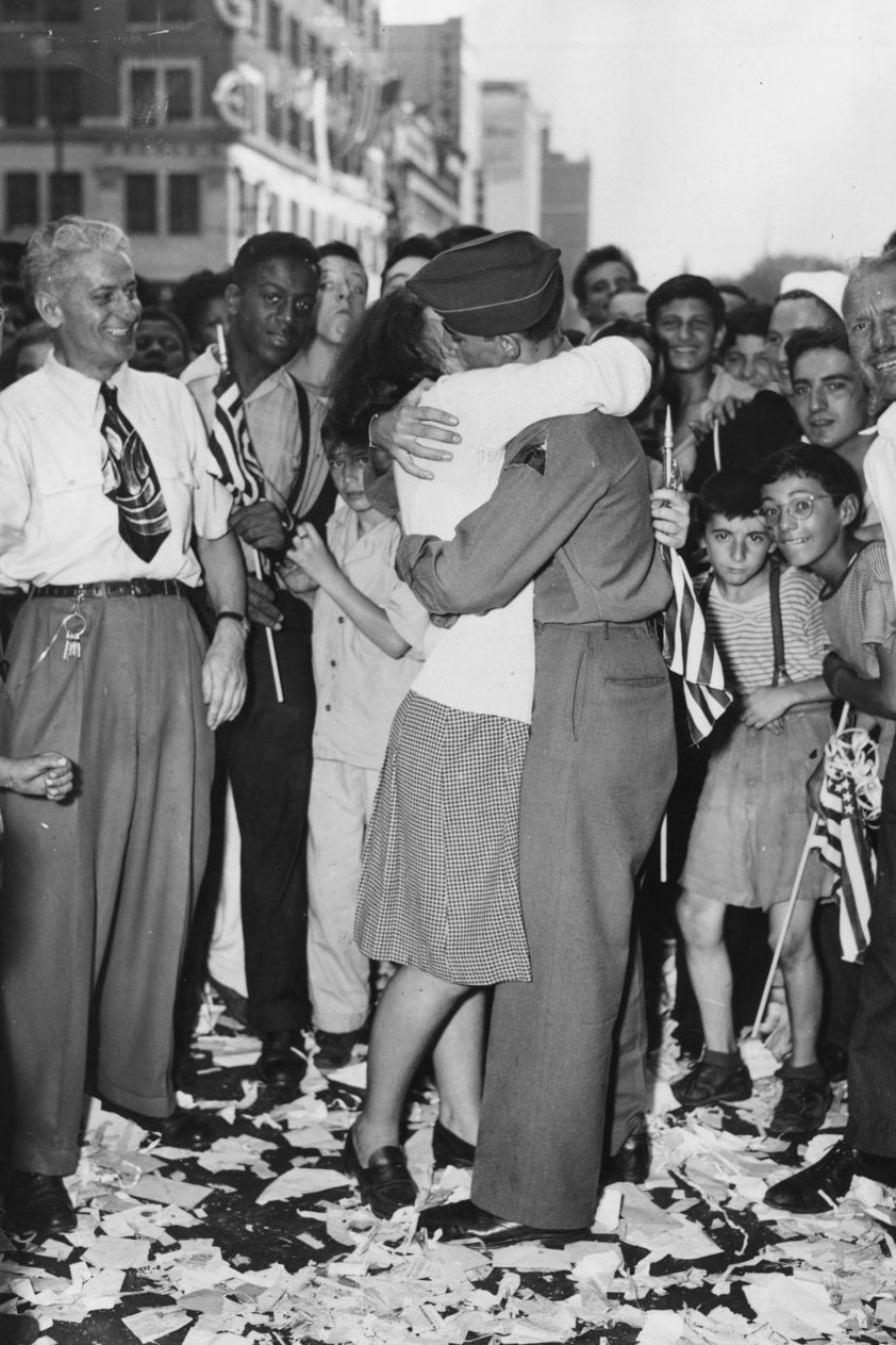 Boy meets girl in the unleashed joy of the VJ Day celebration. August 1945.