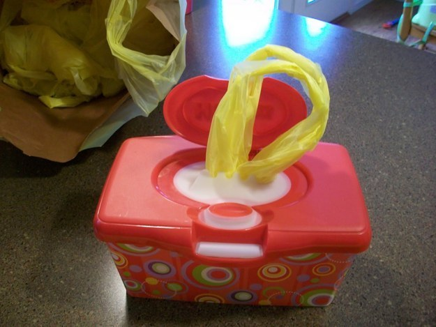 If you live in small quarters where even an odor-free diaper pail is too stinky, you can forgo the pail by filling an empty wipes dispenser with grocery store bags.
