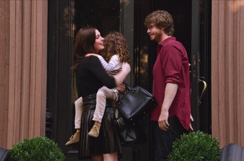 Hathaway with JoJo Kushner as Jules' daughter Paige and Anders Holm' as Jules' husband Matt in The Intern.