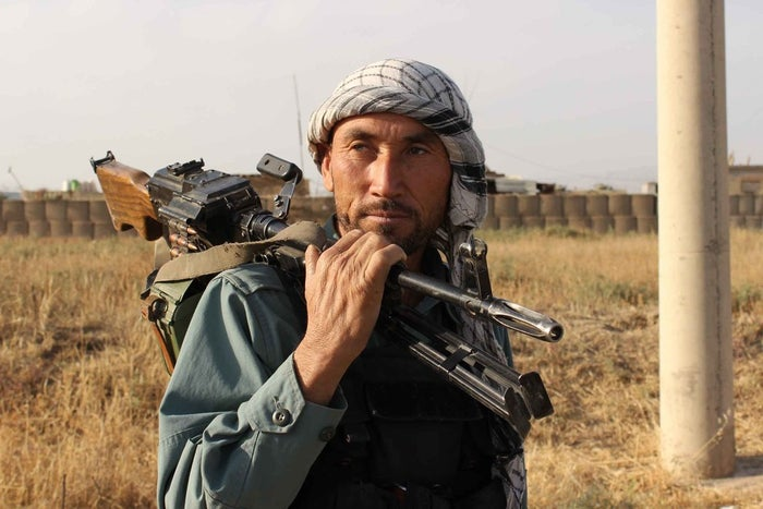 An Afghan policeman holds a gun on his shoulder a day after Taliban insurgents overran the strategic northern city of Kunduz, Sept. 29.