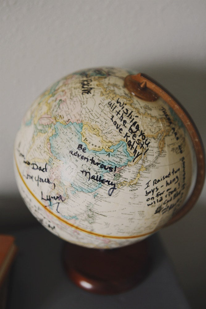 Have your shower guests personalize a globe with well-wishes for the baby.