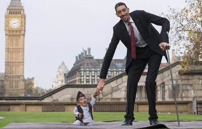 Chandra Dangi poses for pictures with the world's tallest man, Sultan Kosen, in London on Nov. 13, 2014.