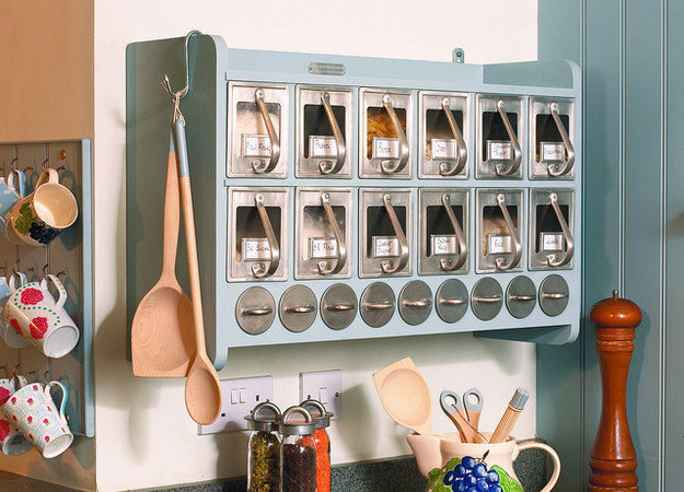 Keep your baking supplies and dry goods in a wall-mounted cabinet.