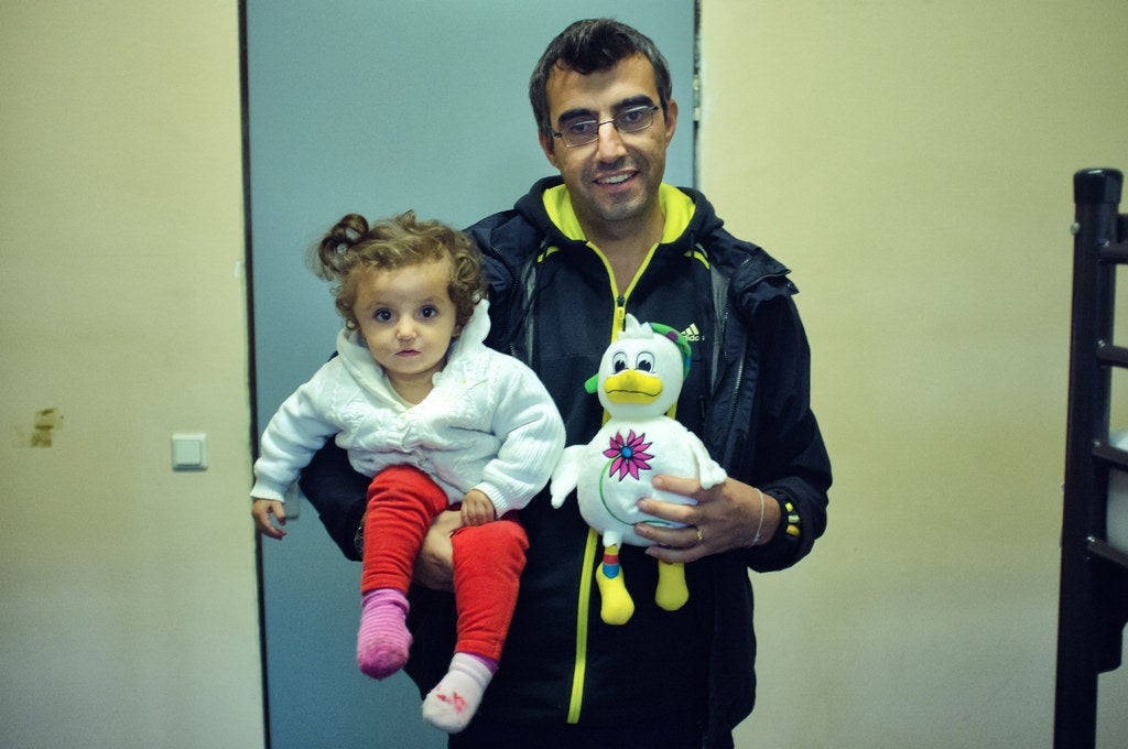 Kawa, professor of French literature at a university in Syria, and Evelin, aged 2, his daughter