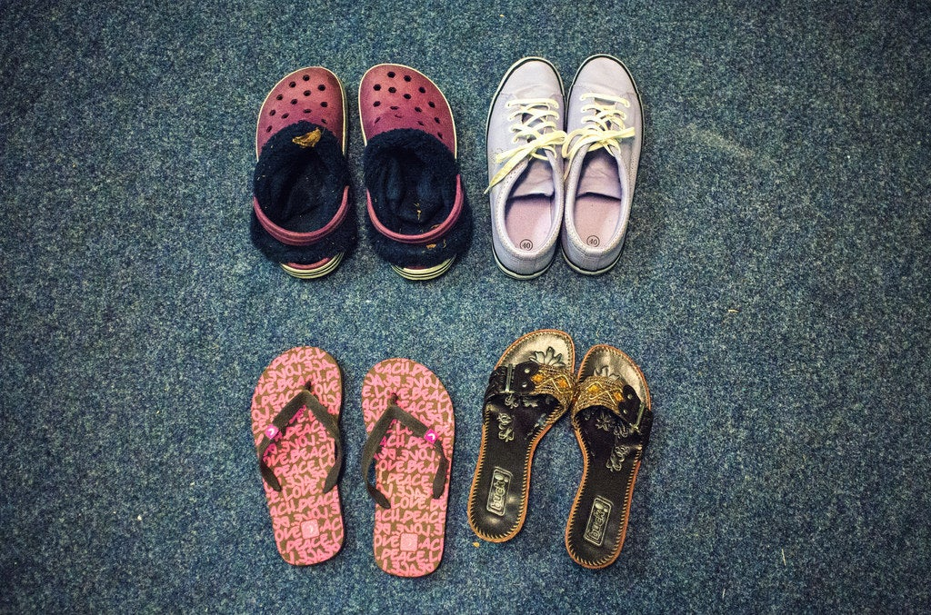 Some second-hand shoes the family has received as donations.
