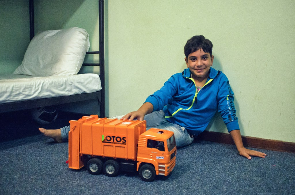 Taha with his favourite toy.