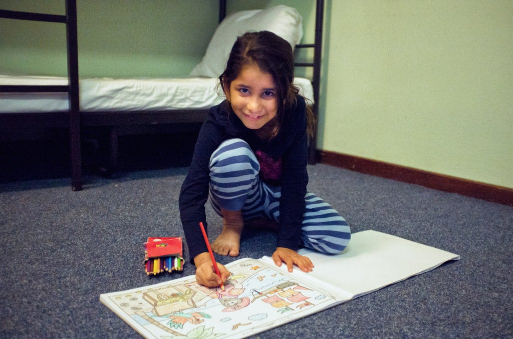 Nour with her colouring book.