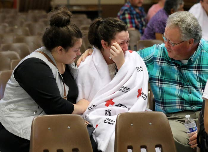 Hannah Miles, center, is reunited with her sister Hailey Miles, left, and father Gary Miles, right, after a shooting at Umpqua Community College in Oregon.