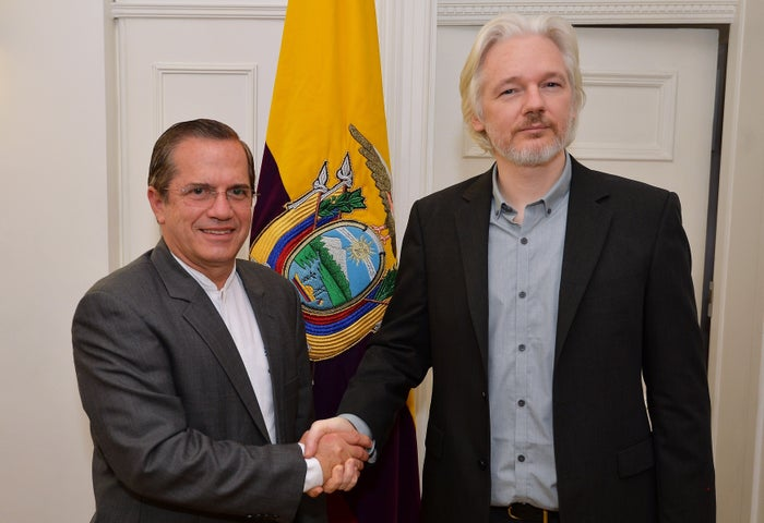 WikiLeaks founder Julian Assange with Ecuador's foreign minister, Ricardo Patino, in Ecuador's London embassy in September 2014.