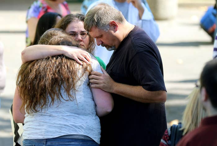Friends and family are reunited with students at the local fairgrounds after a deadly shooting at Umpqua Community College.