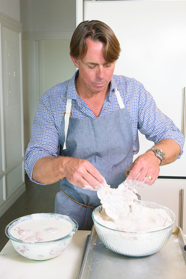 Use your hands to pack the flour onto all sides of the chicken, then, working with one piece at a time, shake off any excess flour...