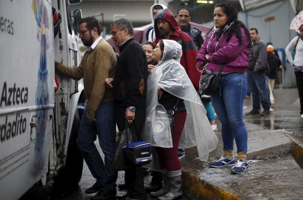 Residents board a bus in Guadalajara