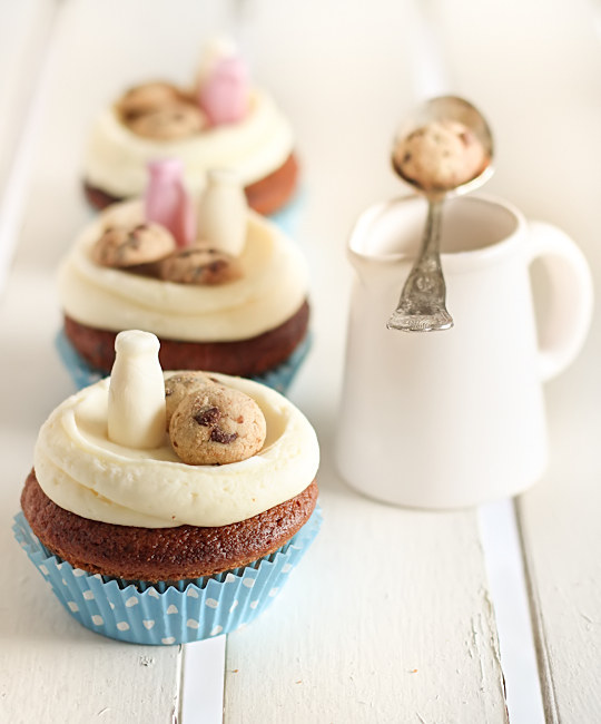 Serve some milk (-y chocolate) and cookies atop a cupcake.