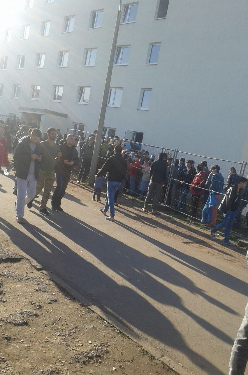 Refugees in line, hoping to get transfer papers.