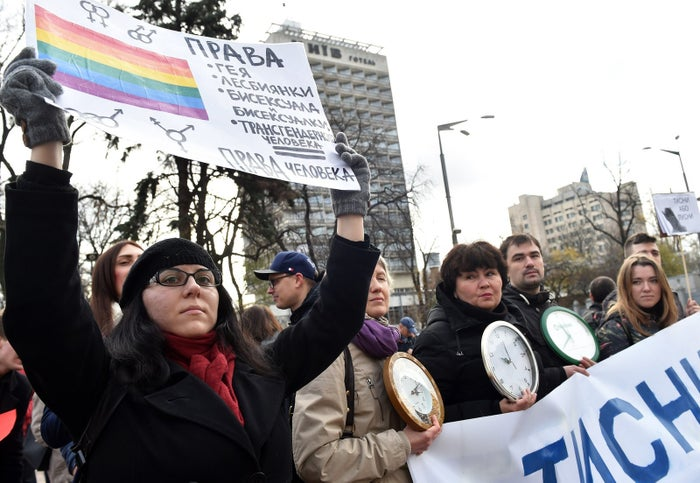 "A woman holds a placard reading ""The rights of gays, lesbians and bisexuals are human rights"" during a demonstration outside the Ukrainian parliament"