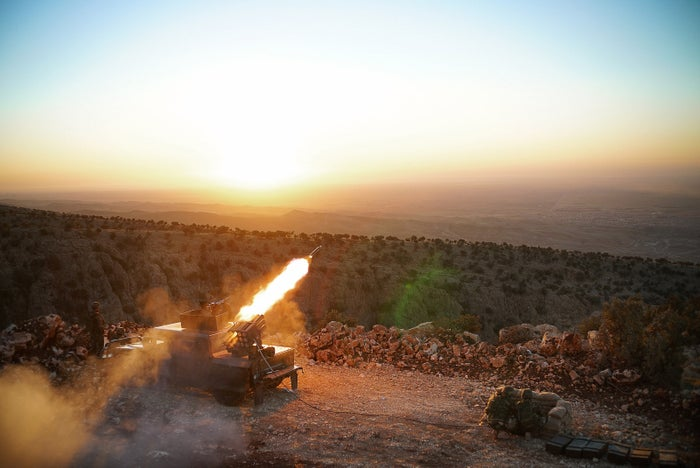 Kurdish forces fire rockets on ISIS positions during the start of their campaign to capture Sinjar.