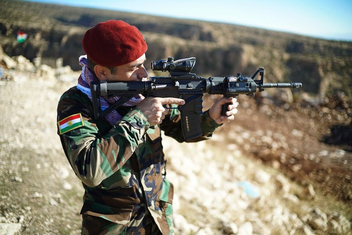 A peshmerga fighter scans ISIS positions.