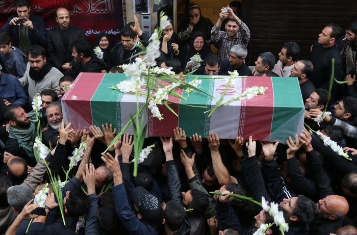 Iranians carry the casket of Abdollah Bagheri, who was killed fighting in Syria.