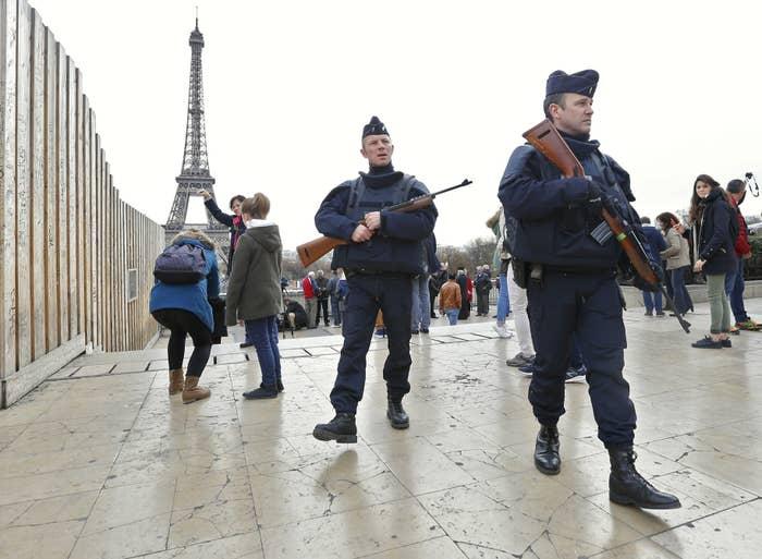Police patrol near the Eiffel Tower.