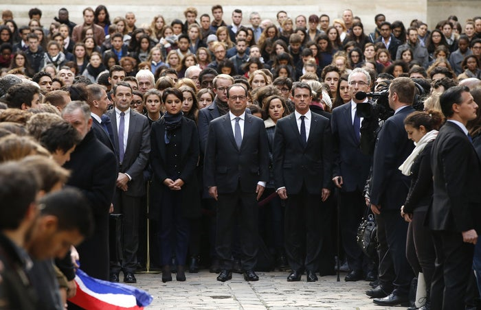 French President François Hollande and members of his cabinet observe a minute of silence at the Sorbonne University.