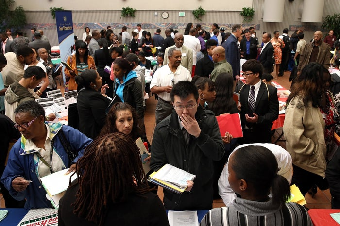 Job seekers meet with a recruiter during a job and career fair at City College of San Francisco in 2013.