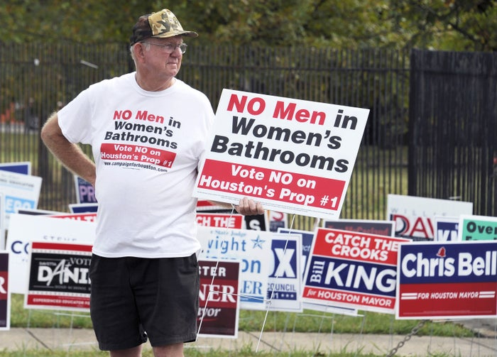 A man urges people to vote against the Houston Equal Rights Ordinance outside an early voting center on Oct. 21.