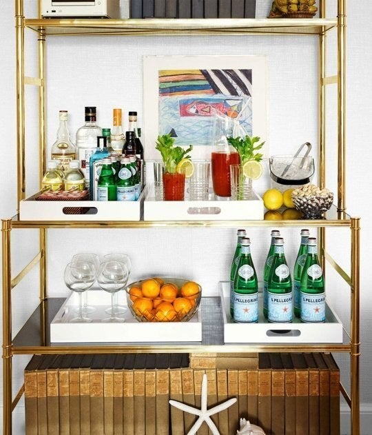 Bar carts are all the rage right now- but they can be super expensive and take up unnecessary space. Try using a lacquer or mirrored tray to display your fanciest bottles and glasses.