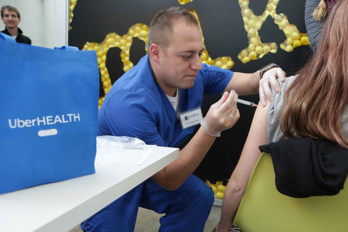 Jessica Funcannon getting a flu vaccination shot from Nurse Jerry Palacios at her workplace during the UberHealth day in Chicago last year.