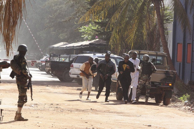 People run to flee from the Radisson Blu Hotel in Bamako, Mali, on Friday.