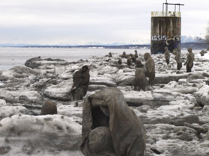 Sculptures made of straw, cement, plaster and burlap, are part of a public art installation at Point Woronzof in Anchorage, Alaska.
