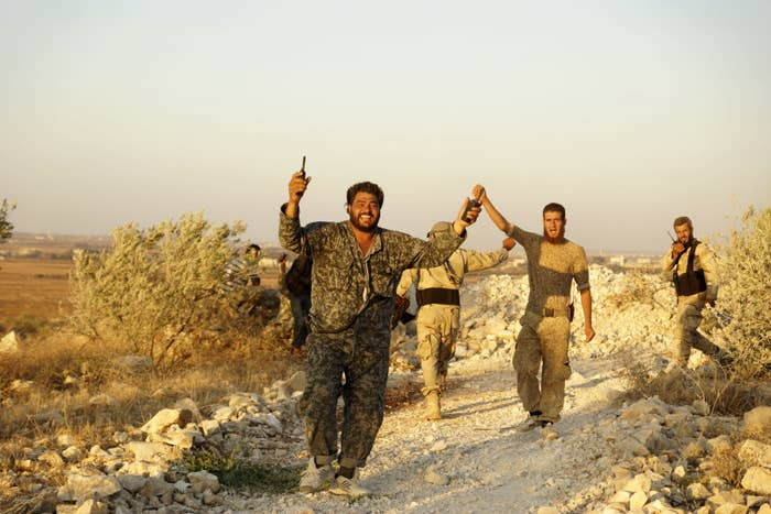 Free Syrian Army fighters celebrate after taking control of Tal al-Zaatar in August