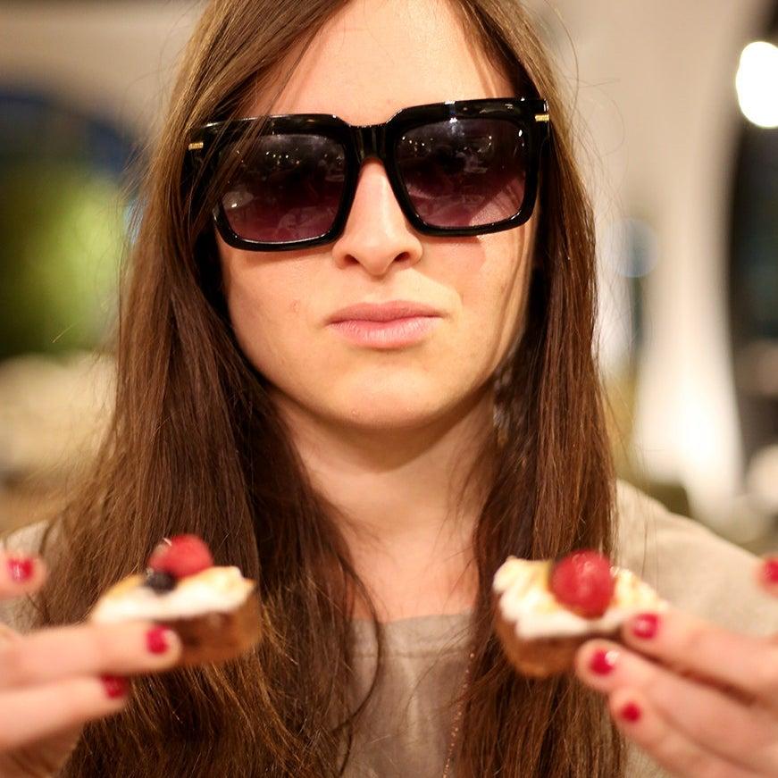 Jen double-fisting desserts.