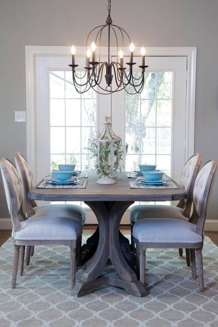 Upgrading lighting in the main rooms can make the whole space feel more expensive.