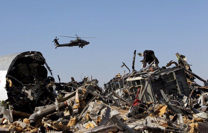 An Egyptian military helicopter flies over debris from the Russian airliner in Egypt's Sinai.