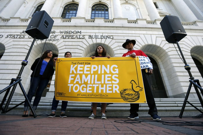 Immigration activists protest outside the federal appeals court in New Orleans.
