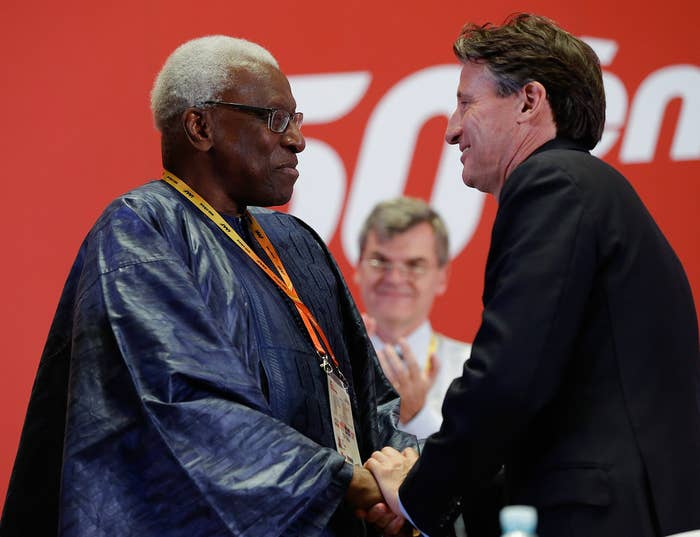 Former International Association of Athletics Federations president Lamine Diack (L) shakes hands with Lord Coe, his successor, in August 2015.
