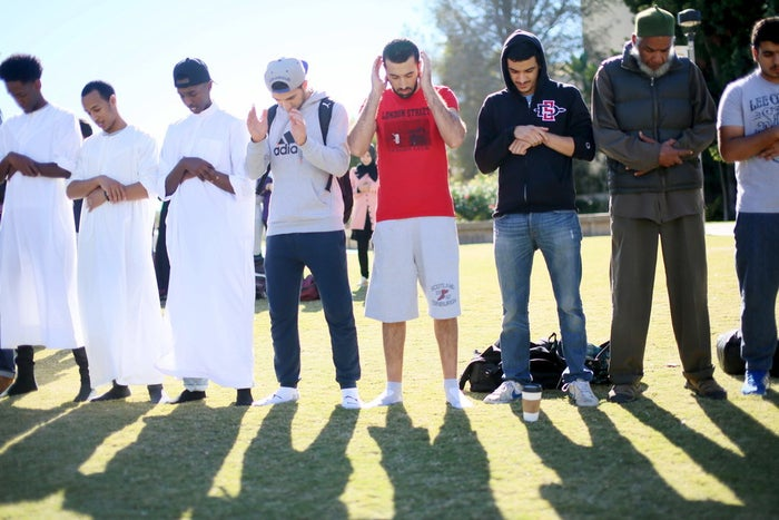Muslim students pray before at a rally against Islamophobia at San Diego State University in San Diego, California, November 23, 2015. REUTERS/Sandy Huffaker