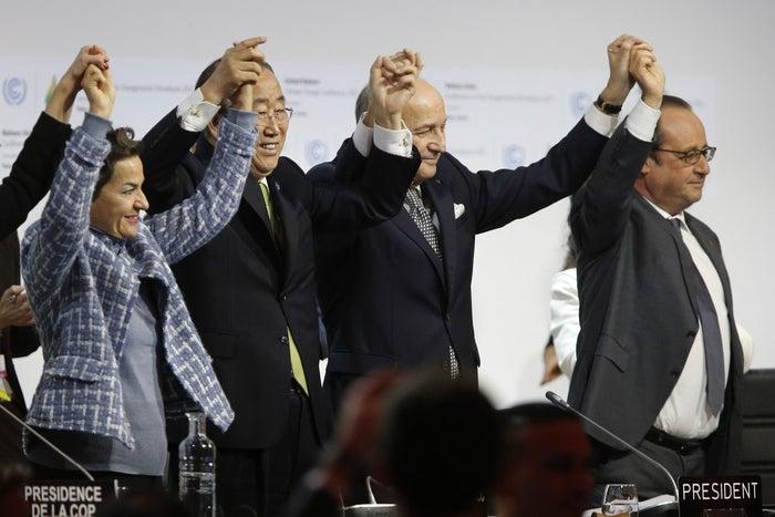 President-Designate of Climate Talks Laurent Fabius (center) celebrates with U.N. Secretary-General Ban Ki-moon and France's President François Hollande Saturday.