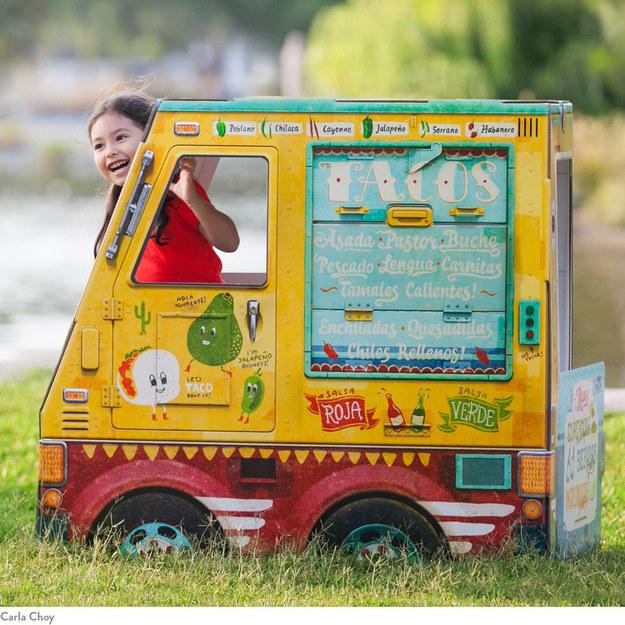 A miniature taco truck playhouse.