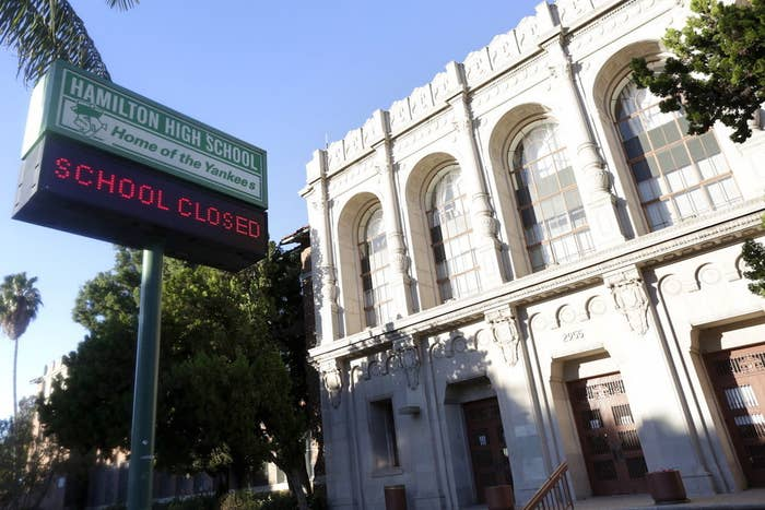 """A sign at Hamilton High School is pictured reading """"School Closed"""" in Los Angeles, California."""