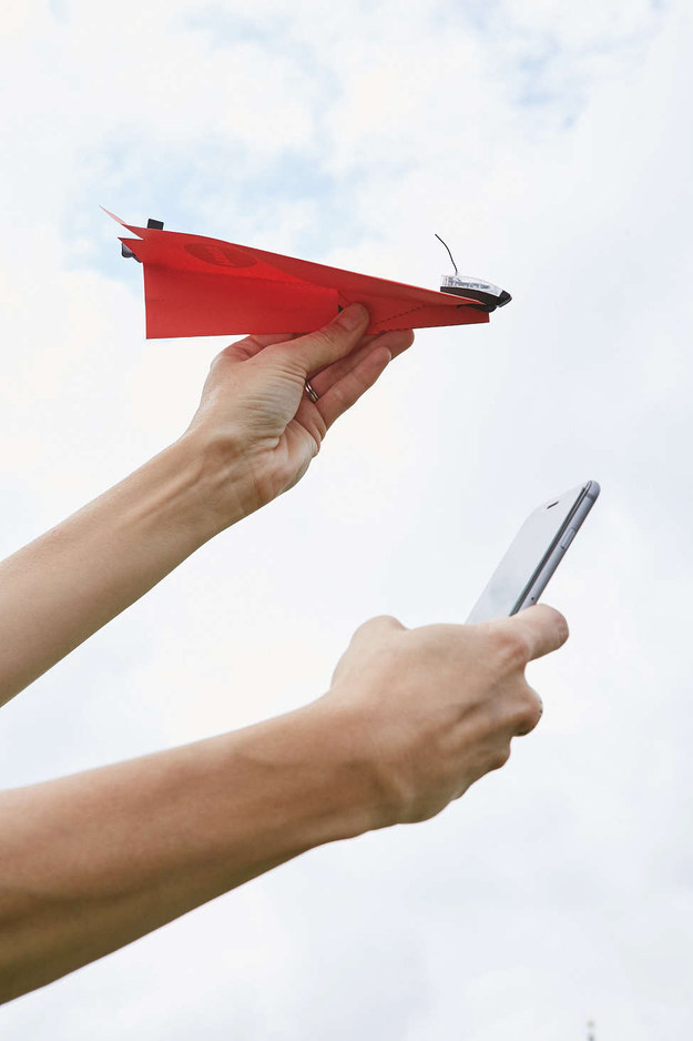 A device that turns a paper airplane into a smartphone-controlled aircraft.