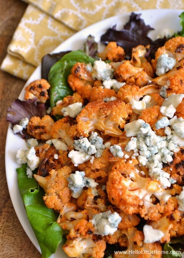 These Spicy Buffalo Cauliflower Bites with Blue Cheese are a delicious veggie twist on a classic tailgating favorite. This Buffalo, NY girl approves! Recipe here.