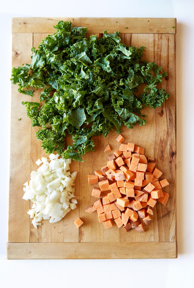 First, prep the sweet potato, onion, and kale.