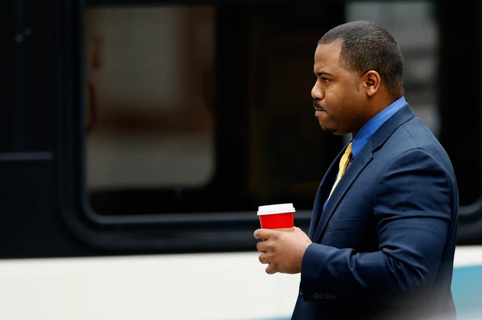 Porter walks to a courthouse for jury selection in his trial.