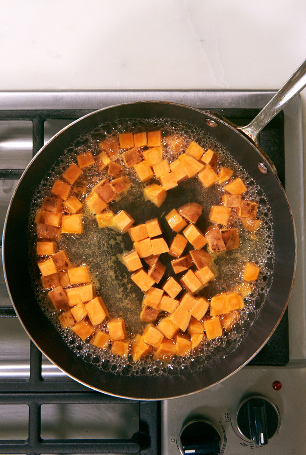 Put the sweet potatoes in a large, nonstick skillet. Add a cup of water, bring it to a boil, then reduce the heat to a simmer and cook until the sweet potatoes are soft on the outside and there's no water left.