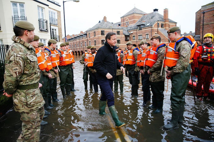 Cameron greets soldiers working on flood relief in York city centre.