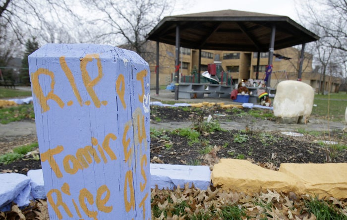 """R.I.P. Tamir Rice"" is written on a block of wood near a memorial for Rice outside the Cudell Recreation Center, Tuesday, Dec. 29, 2015, in Cleveland."